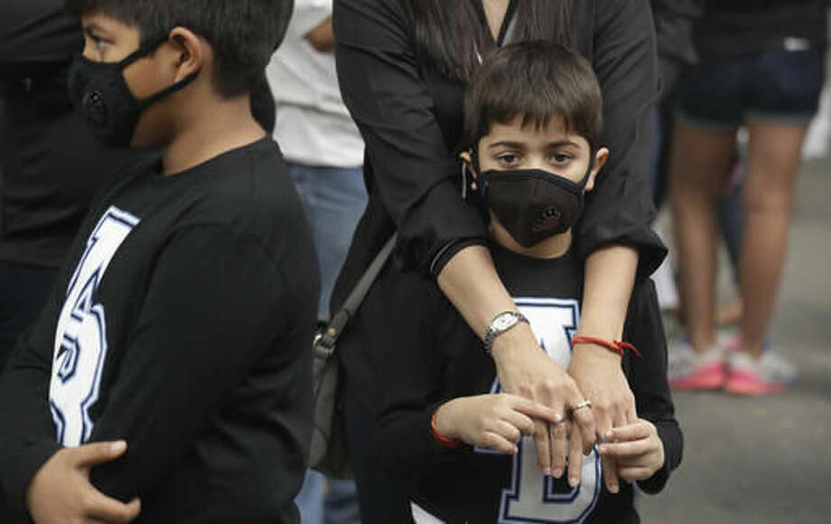 Children wear pollution masks and participate in a protest against air pollution in New Delhi, India, Sunday, Nov. 6, 2016. Even for a city considered one of the worlds dirtiest, the Indian capital hit a new low this week. Air so dirty you can taste and smell it; a gray haze that makes a gentle stroll a serious health hazard. According to one advocacy group, government data shows that the smog that enveloped the city midweek was the worst in the last 17 years. The concentration of PM2.5, tiny particulate pollution that can clog lungs, averaged 12 times the government norm and a whopping 70 times the WHO standards. (AP Photo/Manish Swarup)