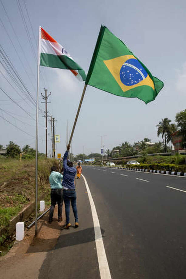 Workers put up a flag of Brazil one of the participating country of BRICS, in Goa, India, Friday, Oct. 14, 2016. The leaders of five big developing nations that banded together in 2009 as the so-called BRICS nations, are set to attend their annual summit Oct. 15-16 in a beach resort town in the western Indian state of Goa. But with their own economies now flagging, some analysts are questioning whether the group, consisting of Brazil, Russia, India, China and South Africa, still has clout in representing nearly half the world's population and a quarter of its economy at $16.6 trillion. (AP Photo/Manish Swarup)