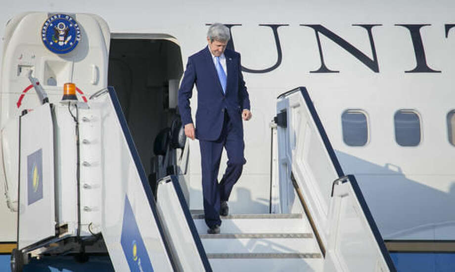 U.S Secretary of State John Kerry disembarks from his aircraft upon his arrival at the airport in Kigali, Rwanda, Thursday, Oct. 13, 2016 where he is due to attend the 28th Meeting of the Parties to the Montreal Protocol on Substances that Deplete the Ozone Layer. Kerry is expected to apply pressure for a deal to quickly phase out hydrofluorocarbons which are used in air conditioners, refrigerators, and insulating foams. (AP Photo)