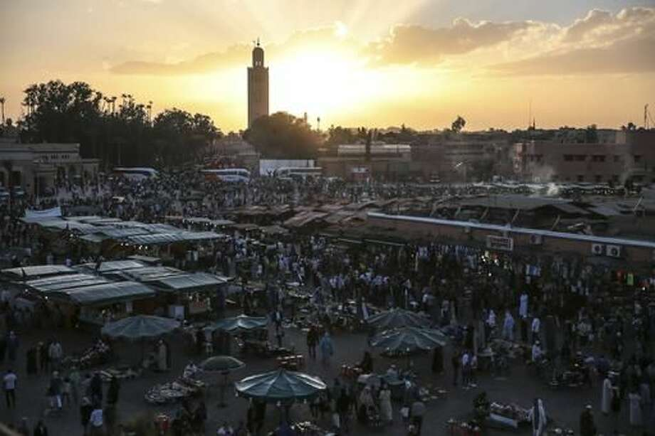 People gather in the landmark Jemaa el-Fnaa square, in Marrakesh, Morocco, Saturday, Nov. 5, 2016. The Climate Conference, known as the COP22, starts Monday in Marrakech and is expected to attract hundreds of participants and state representatives. (AP Photo/Mosa'ab Elshamy)