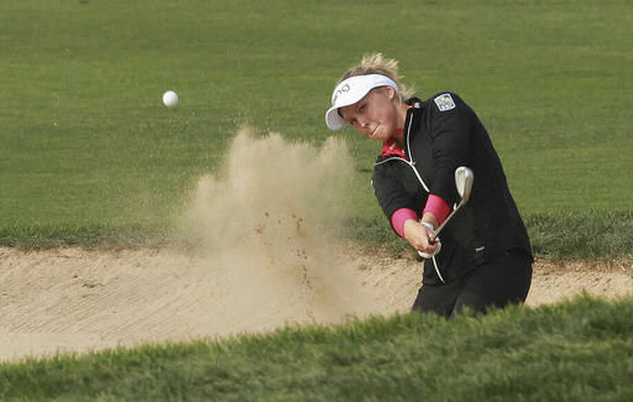 Brooke M. Henderson of Canada plays out of a bunker on the 18th hole during the second round of the LPGA KEB HanaBank Championship 2016 tournament at Sky72 Golf Club in Incheon, South Korea, Friday, Oct. 14, 2016. (AP Photo/Ahn Young-joon)