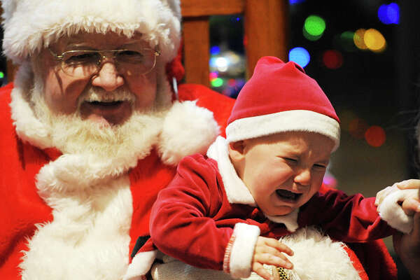 Sixteen-month-old Liam Trotter expresses displeasure while sitting on Santa's lap during the Midland College Holiday Evening event on Thursday, Dec. 1, 2016. James Durbin/Reporter-Telegram