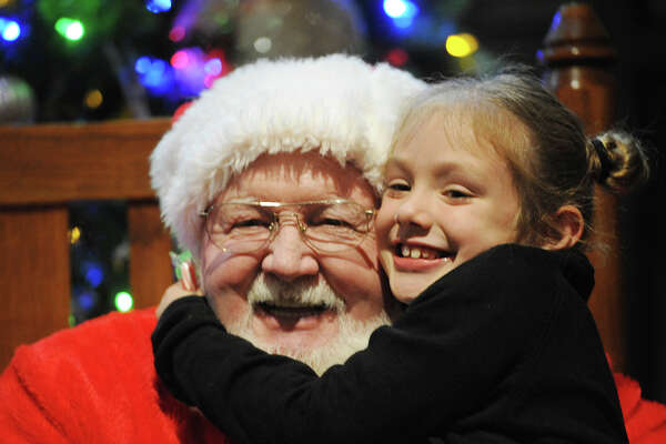 Chloe Patterson, age 7, hugs Santa at the Midland College Holiday Evening event on Thursday, Dec. 1, 2016. James Durbin/Reporter-Telegram