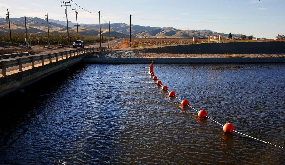 Water flows along the Calfornia Aquaduct through the Central Valley near Westley, California, on Thursday December 1, 2016.