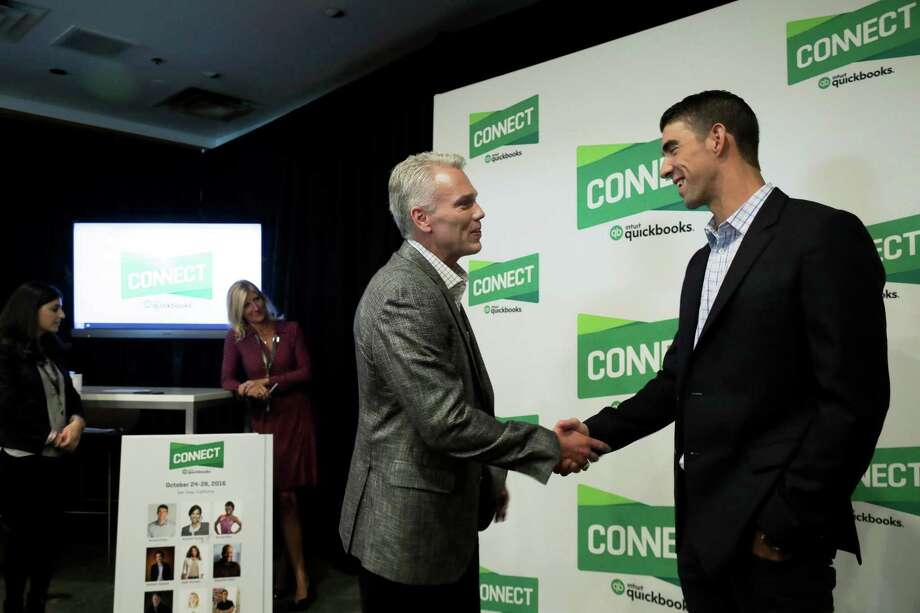 CORRECTS ID TO INTUIT CHAIRMAN AND CEO BRAD SMITH INSTEAD OF QUICKBOOKS CONNECT CHAIRMAN AND CEO BRAND SMITH - In this Tuesday, Oct. 25, 2016, photo, former Olympic swimmer Michael Phelps, right, shakes hands with Intuit Chairman and CEO Brad Smith in San Jose, Calif. Phelps is looking for his next golden opportunity in business after retiring from his sport as the most decorated athlete in Olympic history. He thinks he might find it in Silicon Valley, joining a growing list of athletes and entertainers trying to build upon their fortunes in a technology-driven area teeming with geeky millionaires. (AP Photo/Marcio Jose Sanchez) ORG XMIT: CAMS104 Photo: Marcio Jose Sanchez / Copyright 2016 The Associated Press. All rights reserved.