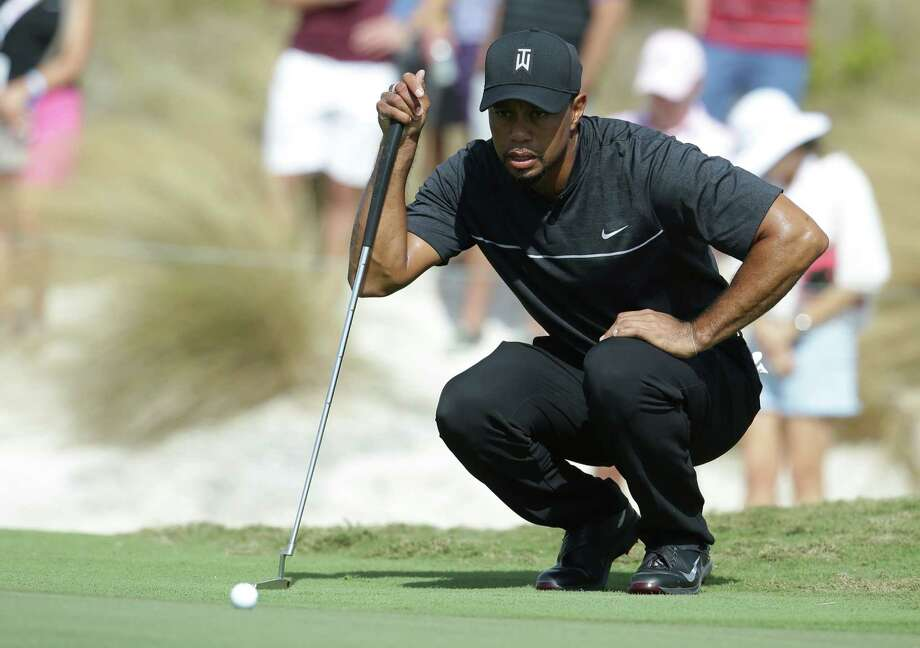 Tiger Woods lines up a putt on the first hole during the first round at the Hero World Challenge golf tournament, Thursday, Dec. 1, 2016, in Nassau, Bahamas. (AP Photo/Lynne Sladky) ORG XMIT: BHLS106 Photo: Lynne Sladky / Copyright 2016 The Associated Press. All rights reserved.