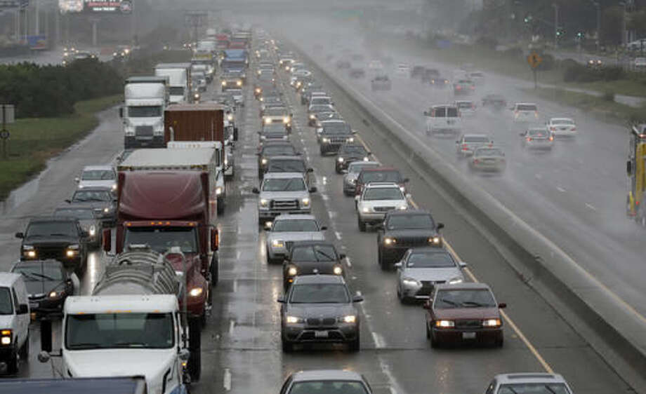 Rain falls as traffic moves north on Interstate 880 in Oakland, Calif., Friday, Oct. 14, 2016.Click through this slideshow to see which cities are the worst for traffic.