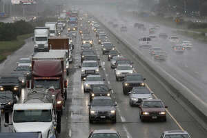 Rain falls as traffic moves north on Interstate 880 in Oakland, Calif., Friday, Oct. 14, 2016. Rain, wind and coastal flooding is expected to affect the San Francisco Bay Area through part of Saturday. (AP Photo/Marcio Jose Sanchez)