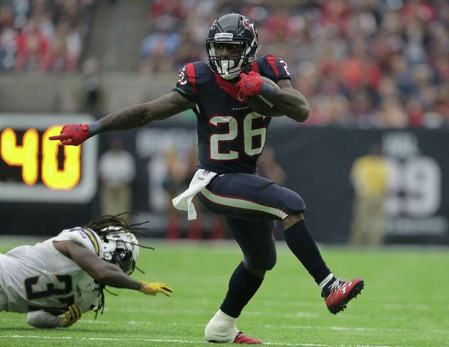 Texans running back Lamar Miller breaks away from San Diego Chargers strong safety Jahleel Addae in the third quarter on Nov. 27, 2016, in Houston. Photo: Elizabeth Conley /Houston Chronicle / © 2016 Houston Chronicle