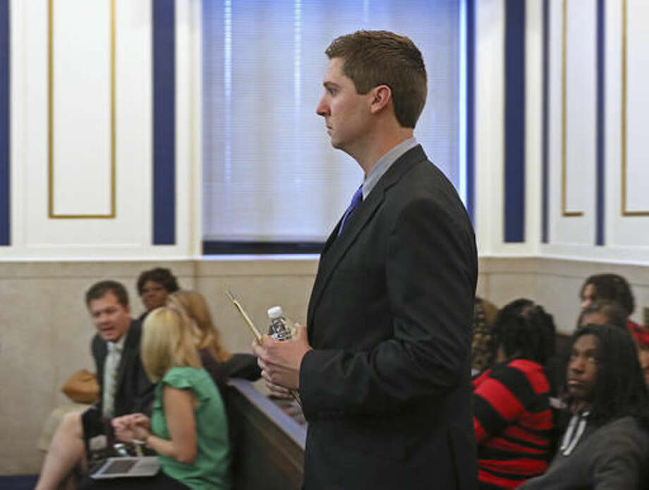 Ray Tensing walks into the courtroom of Common Pleas Judge Megan Shanahan on day three of testimony, Friday, Nov. 4, 2016, in Cincinnati. The former University of Cincinnati Police Officer is charged with fatally shooting Sam DuBose while on duty during a routine traffic stop on July 19, 2015. (Cara Owsley/The Cincinnati Enquirer via AP, Pool)