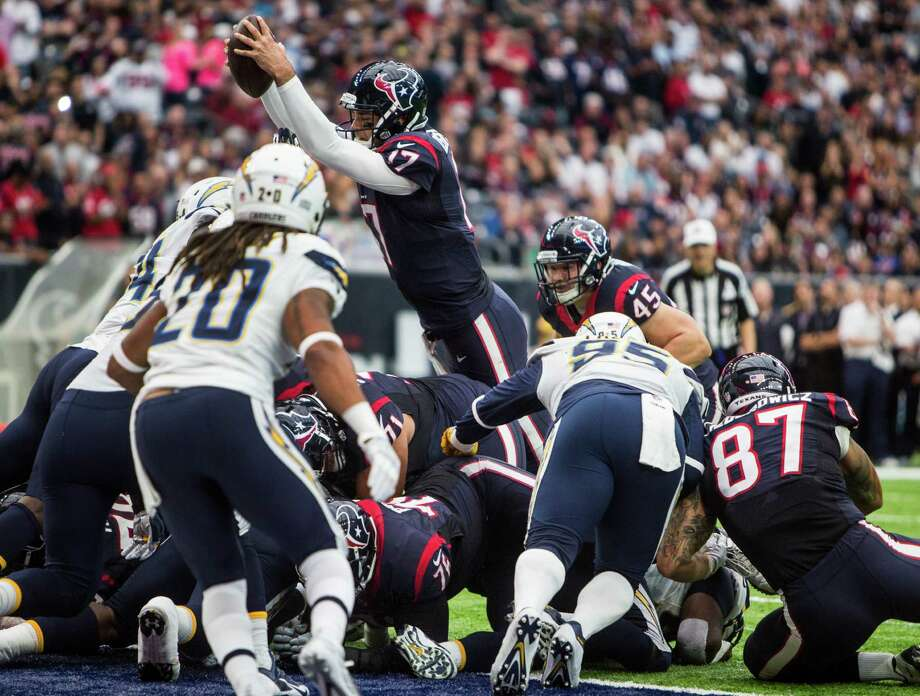 Texans quarterback Brock Osweiler (17) leaps over the goal line for a 1-yard touchdown against San Diego. The Texans have scored a touchdown only 13 of the 30 times they have been inside their opponents' 20-yard line. Photo: Brett Coomer, Staff / © 2016 Houston Chronicle