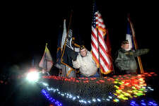 """Veterans wave to the crowd from their lighted float during the 16th annual Lumberton Lighted Christmas Parade through Village Creek Parkway Thursday night. They were among the participants leading the parade, the theme of which was """"Christmas on the Creek - Honoring Our Heroes."""" Lighted trucks and floats from various organizations and school bands joined in the festivities, which included a float carrying Santa and Mrs. Claus. Photo taken Thursday, December 1, 2016 Kim Brent/The Enterprise"""