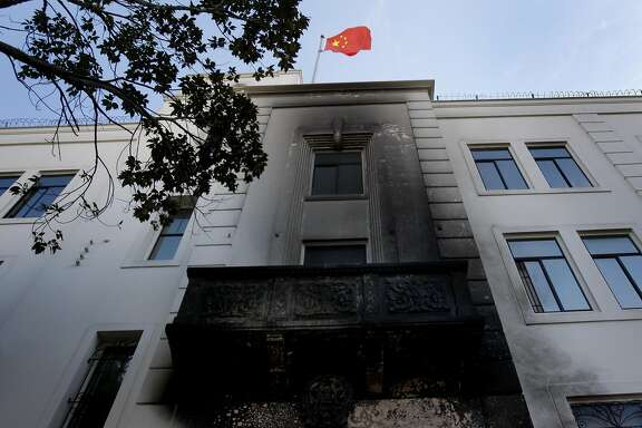 The Chinese flag flies above the consulate Thursday January 2, 2014 in San Francisco, Calif. Unidentified persons splashed gasoline on the main entrance to the Chinese consulate on Geary and Laguna Streets and set it ablaze causing damage to the door and exterior.
