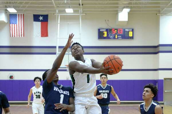 Josh Lewis (1) of Mayde Creek drives to the hoop in the first half of a boys basketball game between the Mayde Creek Rams and Tomball Memorial Wildcats during the Katy ISD-Phillips 66 Tournament on Thursday December 1, 2016 at Morton Ranch, Katy, TX.