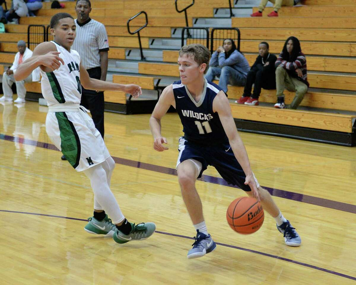 Trent Rosenauer (11) of Tomball Memorial dribbles out of the corner in the second half of a boys basketball game between the Mayde Creek Rams and Tomball Memorial Wildcats during the Katy ISD-Phillips 66 Tournament on Thursday December 1, 2016 at Morton Ranch, Katy, TX.