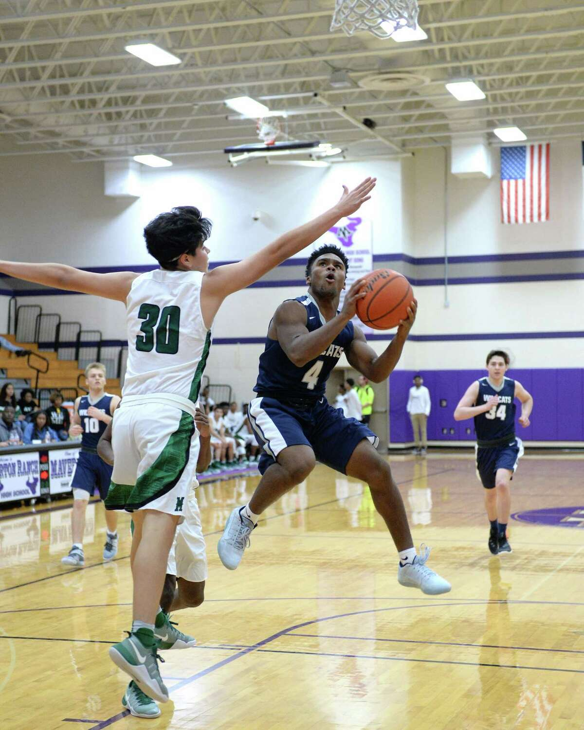 Jackson Key (4) of Tomball Memorial drives to the hoop in the second half of a boys basketball game between the Mayde Creek Rams and Tomball Memorial Wildcats during the Katy ISD-Phillips 66 Tournament on Thursday December 1, 2016 at Morton Ranch, Katy, TX.