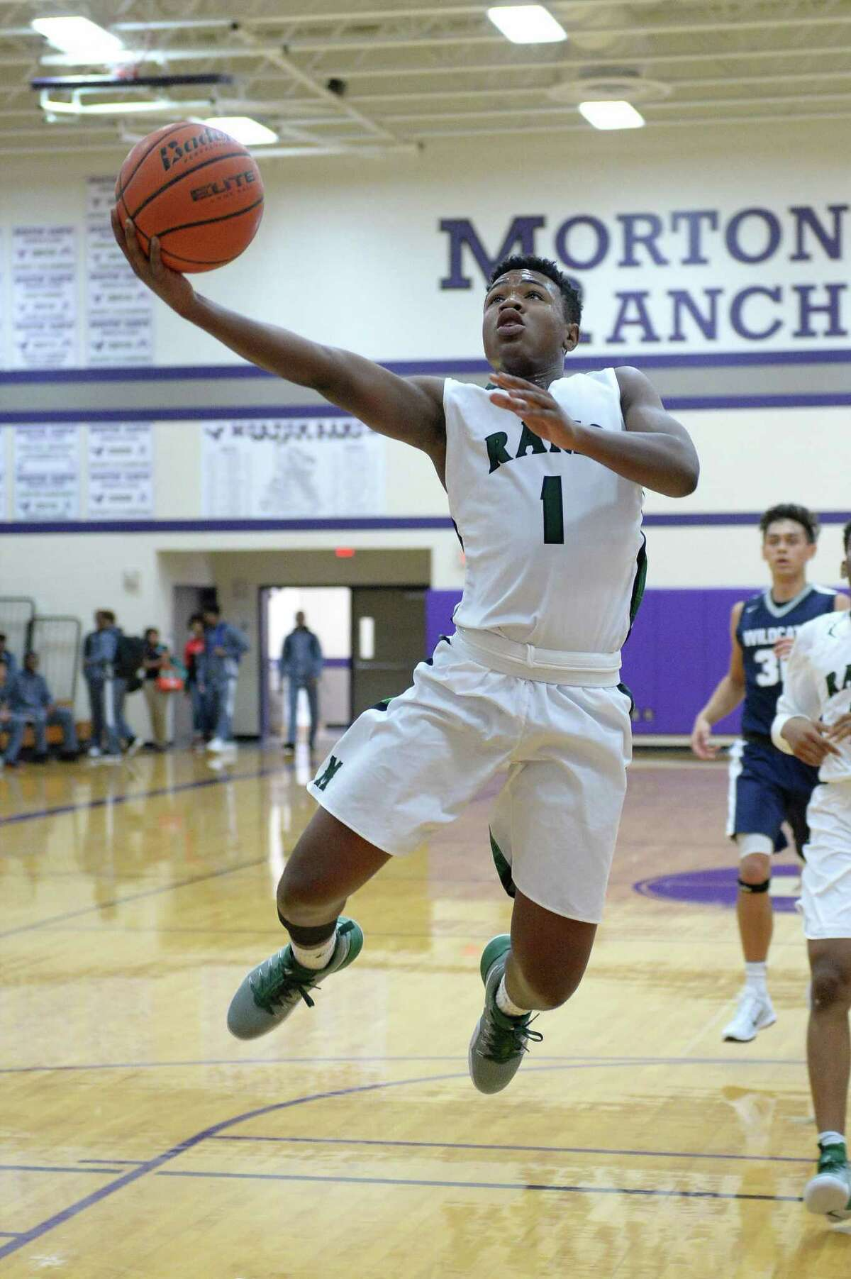 Josh Lewis (1) of Mayde Creek goes airborne for a layup in the second half of a boys basketball game between the Mayde Creek Rams and Tomball Memorial Wildcats during the Katy ISD-Phillips 66 Tournament on Thursday December 1, 2016 at Morton Ranch, Katy, TX.