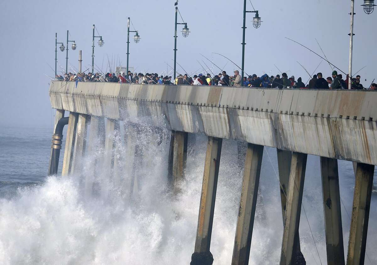 Waves crash into the pilings of the municipal pier in Pacifica. Authorities closed off public access to the pier on February 20 due to dangerously large waves between 15 and 20 feet in height.