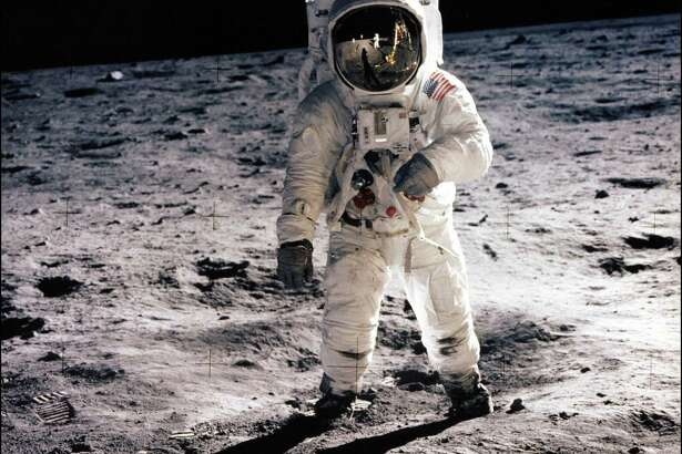 """(FILES) This July 20, 1969 file photo shows astronaut Edwin E. Aldrin Jr.  walking on the surface of the moon near the leg of the Lunar Module (ML) """"Eagle"""" and astronaut Neil Armstrong, during the Apollo 11 extravehicular activity (EVA). On July 16, 1969, NASA astronauts Neil Armstrong, Buzz Aldrin and Michael Collins launched toward the moon atop a Saturn V rocket. Four days later, on July 20, Armstrong and Aldrin landed their Eagle lander at Tranquility Base on the moon as Collins remained in orbit aboard the command module. The 45 year anniversary of the landing will be marked on July 20, 2014.  AFP PHOTO / NASA/HANDOUT  = RESTRICTED TO EDITORIAL USE - MANDATORY CREDIT """"AFP PHOTO / NASA / HANDOUT"""" - NO MARKETING NO ADVERTISING CAMPAIGNS - NO A LA CARTE SALES/DISTRIBUTED AS A SERVICE TO CLIENTS =HO/AFP/Getty Images"""