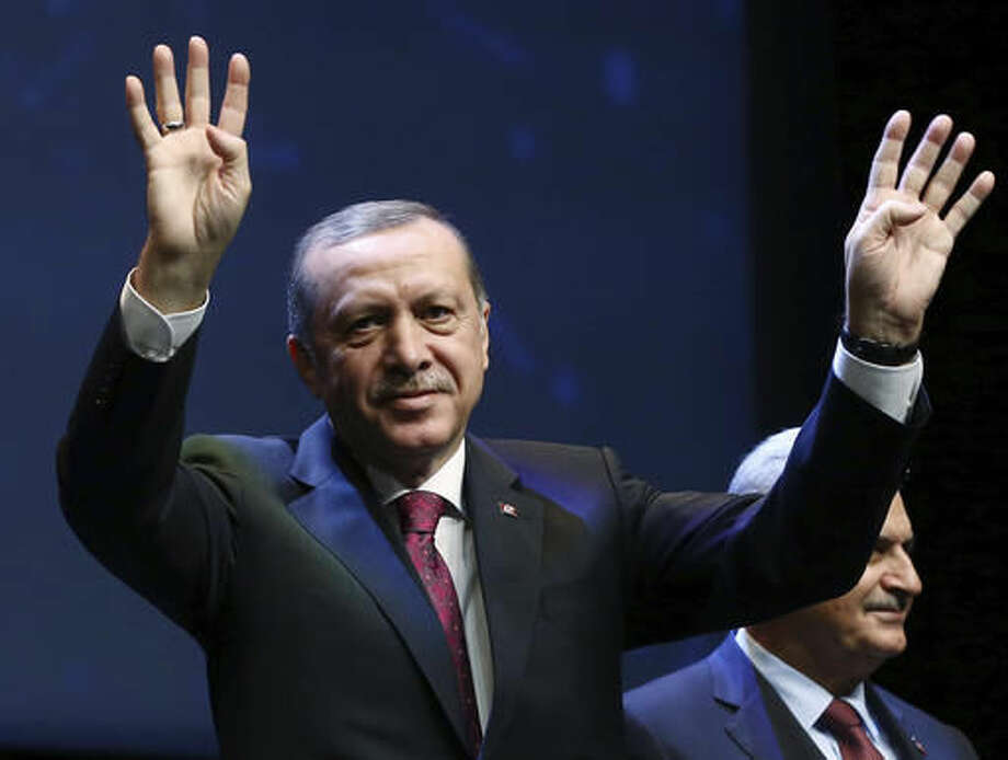 Turkey's President Recep Tayyip Erdogan waves as he addresses an energy meeting in his palace in Ankara, Turkey, Monday, Nov. 7, 2016. Erdogan has reiterated the country's opposition to the use of Syrian Kurdish fighters in the fight against the Islamic State group. Turkey considers U.S.-backed Syrian Kurdish militia, the People's Protection Units, or YPG, and its political wing as terror organizations.(Kayhan Ozer, Presidential Press Service/Pool photo via AP)