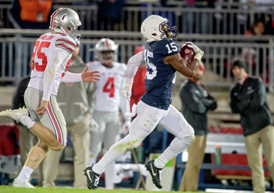 FILE - In this Oct. 22, 2016, file photo, Penn State's Grant Haley returns a blocked field goal for a touchdown against Ohio State in an NCAA college football game, in State College, Pa. The blocked field goal in the fourth quarter against Ohio State changed Penn State's season. The Nittany Lions have not lost since and Happy Valley is happier than it's been with its football team in the five years since a scandal shook the program and the school. (Abby Drey/Centre Daily Times via AP, File) ORG XMIT: PASTA201 Photo: Abby Drey / Centre Daily Times