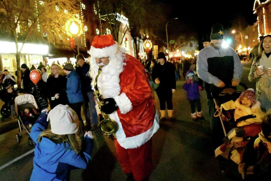 """Sax-o-Claus, also known as Luke McNamee, center, plays """"Santa Claus is Coming to Town"""" on the saxophone during the Victorian Street Walk on Thursday, Dec. 1, 2016, on Broadway in Saratoga Springs, N.Y. (Cindy Schultz / Times Union) Photo: Cindy Schultz / Albany Times Union"""