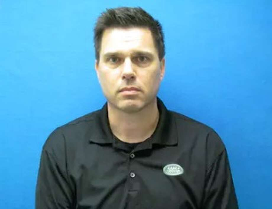 Matthew Thomas was arrested and charged after being accused of emailing nude photos of a minister's wife to a website for swingers. Photo: Grapevine Police Department