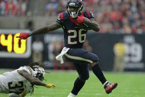 Houston Texans running back Lamar Miller (26) breaks away from San Diego Chargers strong safety Jahleel Addae (37) in the third quarter on Sunday, Nov. 27, 2016, in Houston. ( Elizabeth Conley / Houston Chronicle )