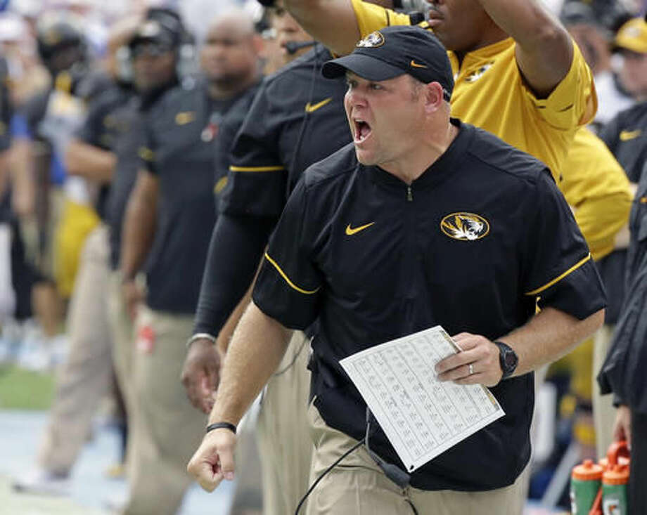 Missouri head coach Barry Odom shouts encouragement to his players during the first half of an NCAA college football game against Florida, Saturday, Oct. 15, 2016, in Gainesville, Fla. (AP Photo/John Raoux)