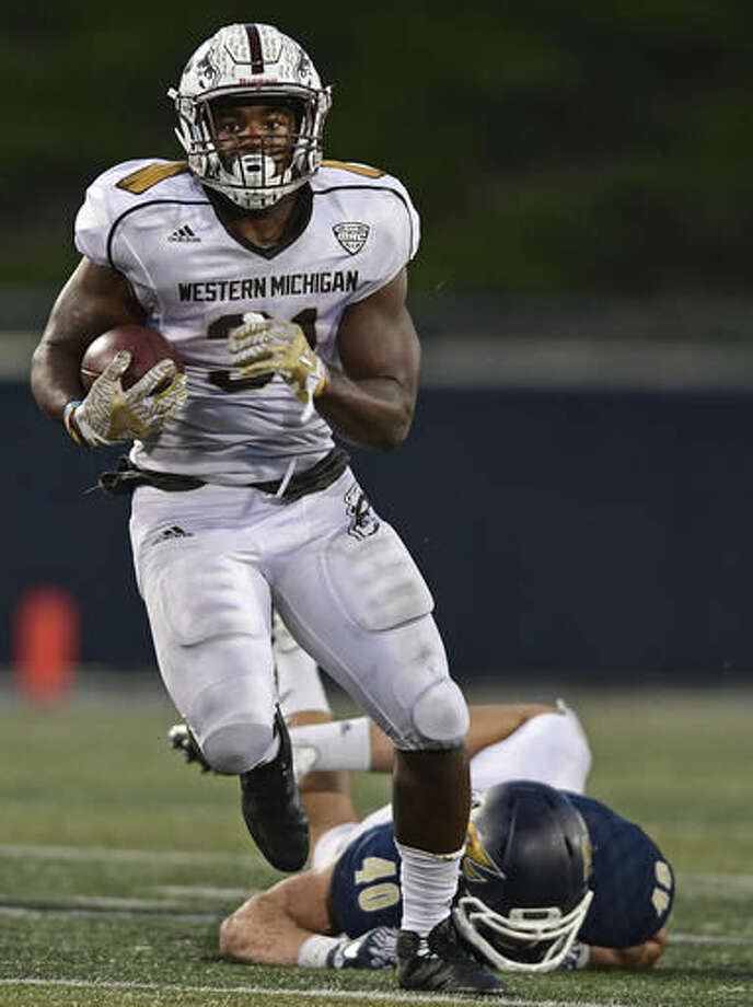 Western Michigan running back Jarvion Franklin runs in the fourth quarter of an NCAA college football game against Akron, Saturday, Oct. 15, 2016, in Akron, Ohio. (AP Photo/David Dermer)