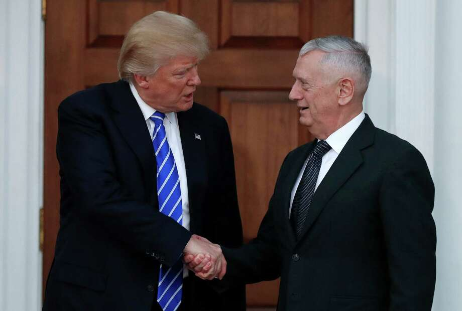 FILE - In this Nov. 19, 2016, file photo, President-elect Donald Trump shakes hands with retired Marine Corps Gen. James Mattis as he leaves Trump National Golf Club Bedminster clubhouse in Bedminster, N.J. Trump said at a rally on Dec. 1, that he will nominate Mattis as defense secretary. (AP Photo/Carolyn Kaster, File) ORG XMIT: WX111 Photo: Carolyn Kaster / Copyright 2016 The Associated Press. All rights reserved.