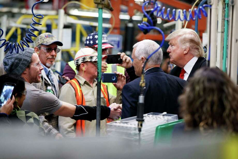 President-elect Donald Trump and Vice President-elect Mike Pence talk with factory workers during a visit to the Carrier factory, Thursday, Dec. 1, 2016, in Indianapolis, Ind. (AP Photo/Evan Vucci) ORG XMIT: INEV106 Photo: Evan Vucci / Copyright 2016 The Associated Press. All rights reserved.