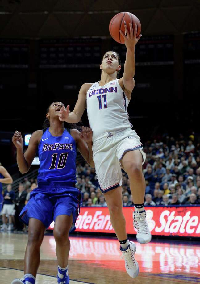 Connecticut's Kia Nurse goes up for a basket as DePaul's Amarah Coleman, left, defends in the first half of an NCAA college basketball game, Thursday, Dec. 1, 2016, in Storrs, Conn. (AP Photo/Jessica Hill) ORG XMIT: CTJH10 Photo: Jessica Hill / AP2016
