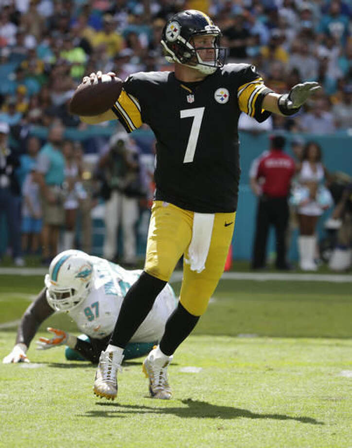 Pittsburgh Steelers quarterback Ben Roethlisberger (7) looks to pass after escaping a tackle by Miami Dolphins defensive tackle Jordan Phillips (97), during the first half of an NFL football game, Sunday, Oct. 16, 2016, in Miami Gardens, Fla. Roethlisberger threw and interception and was injured on the play. (AP Photo/Lynne Sladky)