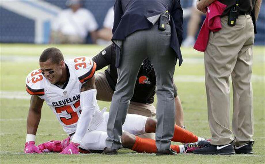 Cleveland Browns free safety Jordan Poyer is attended to after being injured in the first half of an NFL football game against the Tennessee Titans Sunday, Oct. 16, 2016, in Nashville, Tenn. (AP Photo/James Kenney)