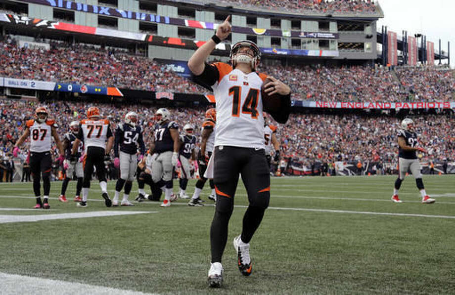 Cincinnati Bengals quarterback Andy Dalton (14) celebrates his running touchdown against the New England Patriots during the first half of an NFL football game, Sunday, Oct. 16, 2016, in Foxborough, Mass. (AP Photo/Elise Amendola)