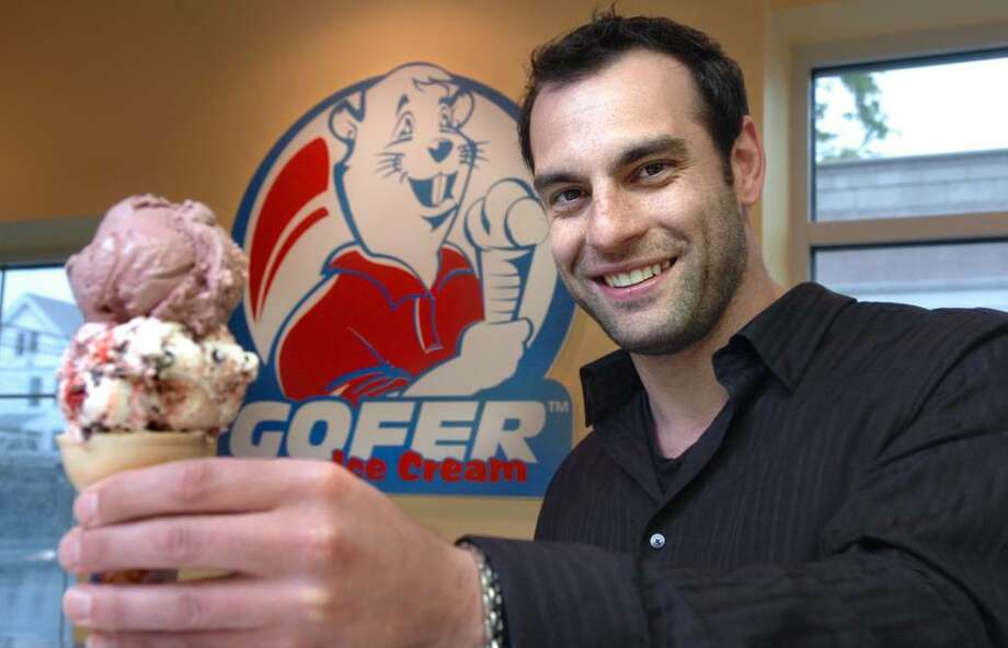 Justin Ragusa, co-owner of Gofer Ice Cream and Smoothies, stands in their newest location in downtown Fairfield Tuesday May 18, 2010. Photo: Autumn Driscoll / Connecticut Post