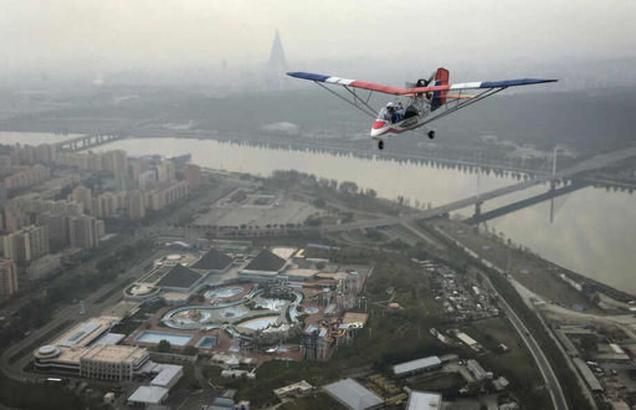 "An ultralight aircraft flies over the city of Pyongyang on Sunday, Oct. 16, 2016, in North Korea. Until a few months ago, if you wanted a bird's eye view of North Korea's capital there was basically only one option: a 150-meter tall tower across the river from Kim Il Sung Square. Now, if you have the cash, you can climb into the backseat of an ultralight aircraft. With the support of North Korean leader Kim Jong Un, who has vowed to give North Koreans more modern and ""cultured"" ways to spend their leisure time, a Pyongyang flying club has started offering short flights over some of the capital's major sights. (AP Photo/Wong Maye-E)"