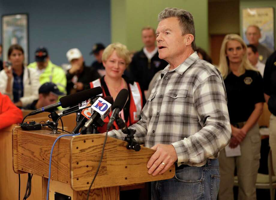 "In this Wednesday, Nov. 30, 2016, photo, Gatlinburg Mayor Mike Werner speaks at a news conference in Gatlinburg, Tenn. Werner has taken part in daily briefings for several days standing in front of TV cameras saying ""everything is going to be OK,"" all while he lost the home he built himself along with all seven buildings of the condominium business he owned. (AP Photo/Mark Humphrey) ORG XMIT: TNMH101 Photo: Mark Humphrey / Copyright 2016 The Associated Press. All rights reserved."