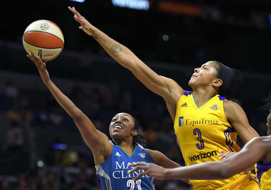 Minnesota Lynx guard Renee Montgomery, left, shoots as Los Angeles Sparks forward Candace Parker defends during the first half in Game 4 of the WNBA Finals, Sunday, Oct. 16, 2016, in Los Angeles. (AP Photo/Mark J. Terrill)