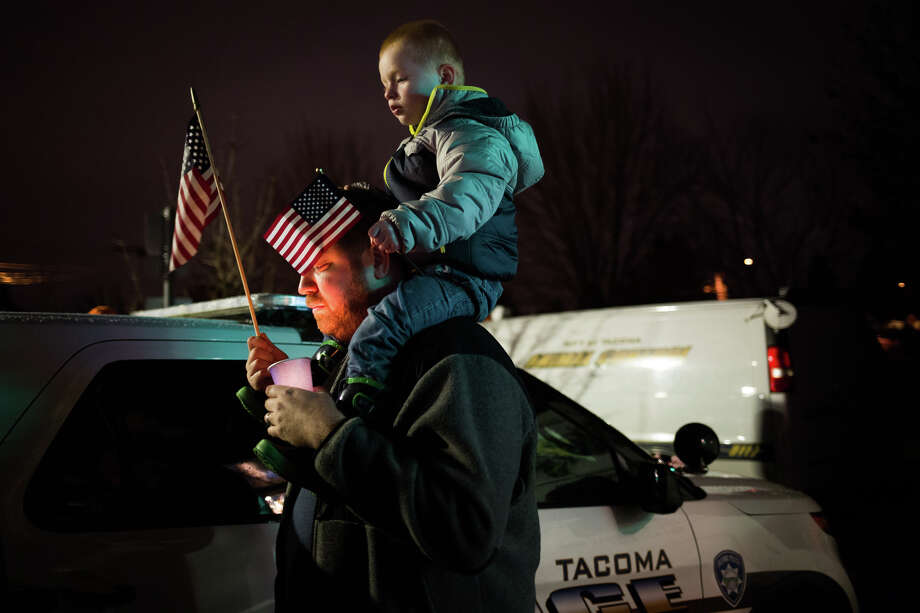 "Hundreds gather at a vigil for fallen Tacoma Police Officer Reginald ""Jake"" Gutierrez at the Tacoma Police Sector 4 substation, Thursday, Dec. 1, 2016,. Gutierrez was shot while responding to a domestic violence call Wednesday night and died shortly after at a hospital. Photo: GRANT HINDSLEY, SEATTLEPI.COM / SEATTLEPI.COM"