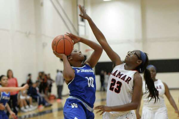 Erika Franklin (10) of Willowridge attempts a shot while guarded by Kayla Rogers (23) of Lamar in the second half of a girls basketball game between the Lamar Texans and the Willowridge Eagles during the Houston ISD Tournament on Thursday December 1, 2016 at The Pavilion, Houston, TX.