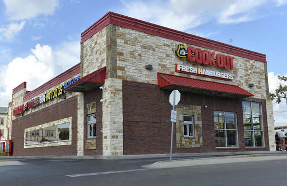 The exterior of the Cook Out restaurant where Trinity Gay, the 15-year old daughter of Olympian and Lexington native Tyson Gay was shot and killed early Sunday morning, Oct. 16, 2016, in the parking lot of the restaurant, in Lexington, Ky. Lexington police said in a statement that officers went to the parking lot of the restaurant about 4 a.m. Sunday after witnesses reported an exchange of gunfire between two vehicles. Police spokeswoman Brenna Angel said police don't believe Trinity Gay was in either of the vehicles involved. (AP Photo/Timothy D. Easley)