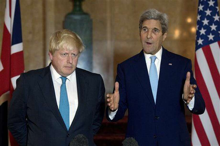 Britain's Foreign Secretary Boris Johnson, left, and U.S Secretary of State John Kerry speak to the media during a joint press conference in London, Sunday, Oct. 16, 2016. With military options all but eliminated, the United States and Britain on Sunday said they were considering new sanctions to pressure the Syrian and Russian governments to halt an offensive against rebel-held parts of Aleppo, Syria's largest city. (Justin Tallis/PA via AP)