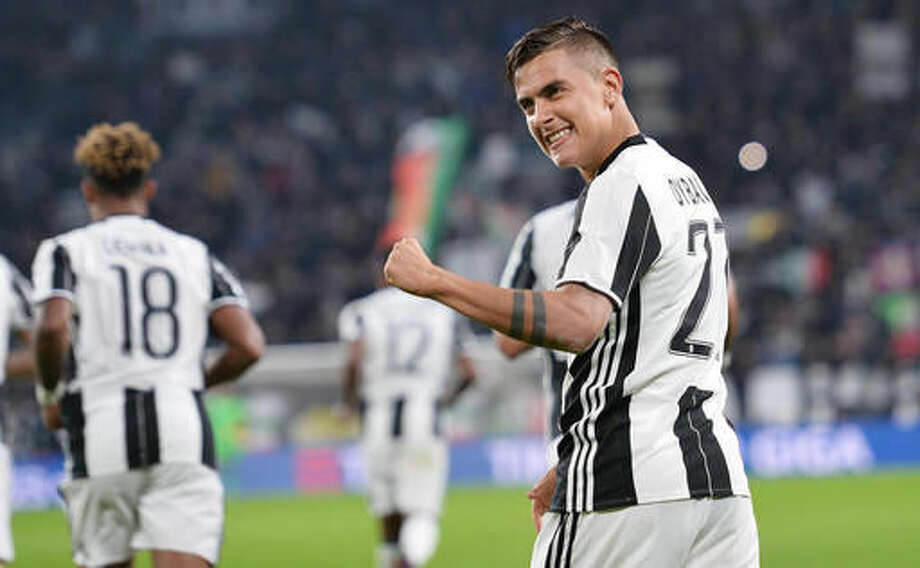 Juventus' Paulo Dybala celebrates after scoring during a Serie A soccer match between Juventus and Udinese, at the Juventus Stadium in Turin, Italy, Saturday, Oct. 15, 2016. (Alessandro Di Marco/ANSA via AP)