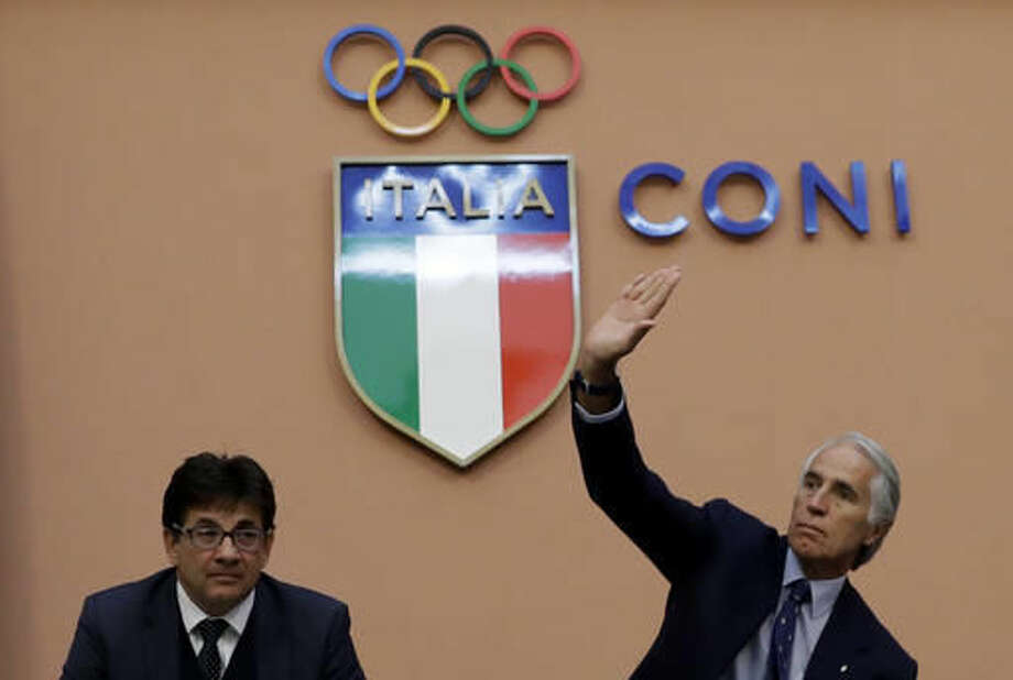 Italian Olympic Committee President Giovanni Malago', right, and Vice-President Luca Pancalli attend a press conference in Rome, Tuesday, Oct. 11, 2016. The Italian Olympic Committee is suspending Rome's bid for the 2024 Games for the time being, while leaving open the possibility for a revival of the candidacy if there is a change in city government. (AP Photo/Alessandra Tarantino)