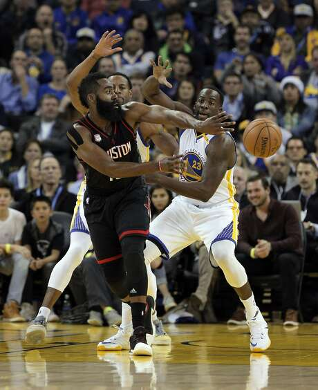 James Harden (13) is guarded by Draymond Green (23) and Andre Iguodala (9) during the first half as the Golden State Warriors played the Houston Rockets at Oracle Arena in Oakland, Calif., on Thursday, December 1, 2016. Photo: Carlos Avila Gonzalez, The Chronicle