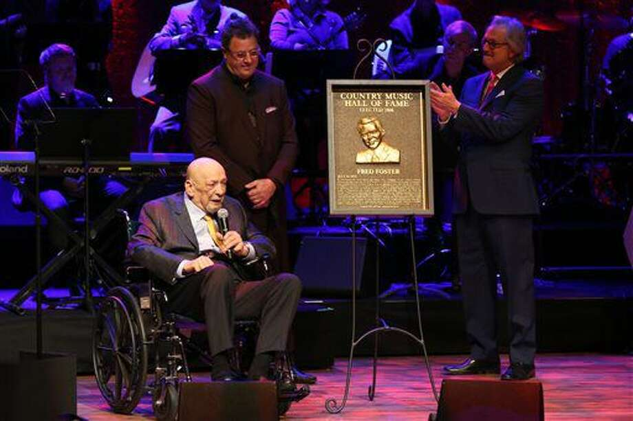 From left, artist and Country Music Hall of Fame inductee Fred Foster is inducted into the Country Music Hall of Fame by artist Vince Gill and Country Music Hall of Fame Director Kyle Young at the Country Music Hall of Fame Medallion Ceremony at the Country Music Hall of Fame and Museum on Sunday, Oct. 16, 2016 in Nashville, Tenn. (Photo by Laura Roberts/Invision/AP)