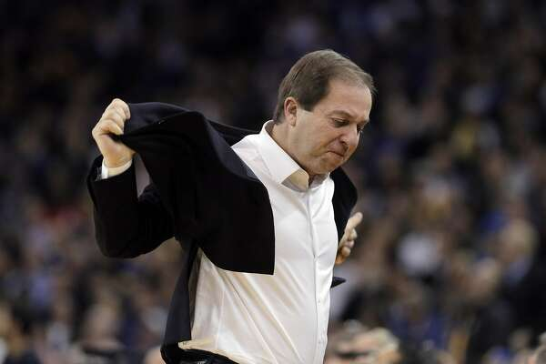 Warriors owner Joe Lacob reacts to several technical fouls called in succession against the Warriors players and coach during the first half as the Golden State Warriors played the Houston Rockets at Oracle Arena in Oakland, Calif., on Thursday, December 1, 2016.