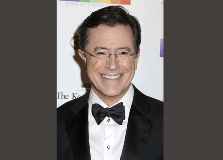 "FILE - In this Dec. 6, 2015 file photo, Stephen Colbert attends the 38th Annual Kennedy Center Honors at The Kennedy Center Hall of States in Washington. Showtime announced Monday, Oct. 17, that Colbert will host a live, one-hour Election Night special from the same Ed Sullivan Theater where the comic tapes the ""Late Show"" every night. Colbert's special will start at 11 p.m. ET. (Photo by Greg Allen/Invision/AP, File)"